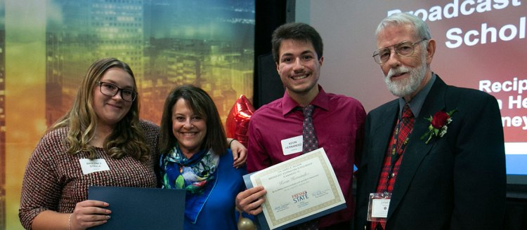 James Wilson (right) with recipients of the James R. Wilson Broadcast Scholarship Brittney Steele (left) and Kevin Hernandez (second from right) along with Professor Faith Sidlow (second from left).