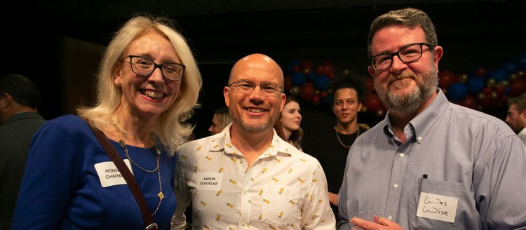 College of Arts and Humanities interim Dean Honora Chapman with  MCJ faculty Aaron Schuelke and Wes Wise.