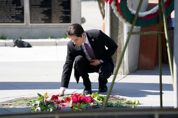Provost and Vice President for Academic Affairs Dr. Saúl Jiménez-Sandoval lays a rose in the Armenian Genocide Memorial at Fresno State. Photo by Cary Edmondson.