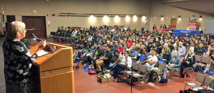 Department of English lecturer Tanya Nichols, who has coordinated the Young Writers' Conference since 2007, welcomes area high school students and teachers to campus in 2017. Photo by Jefferson Beavers.