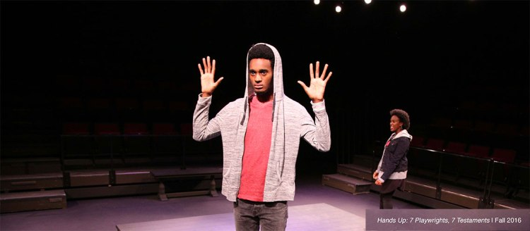 "Student Joshua Slack has his hands up in the 2016 production ""Hands Up: 7 Playwrites, 7 Testaments"