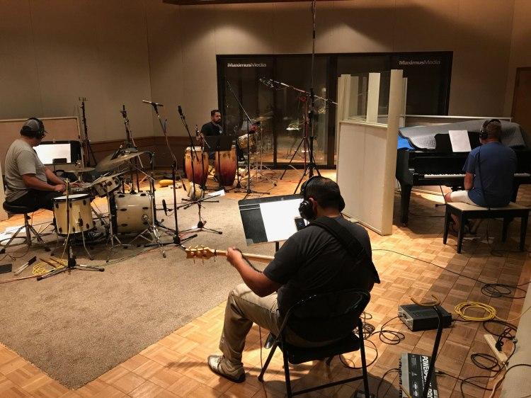 Nathan Guzman (drums), Richard Juarez (percussion), Patrick Olvera (bass) and Craig VonBerg (piano).