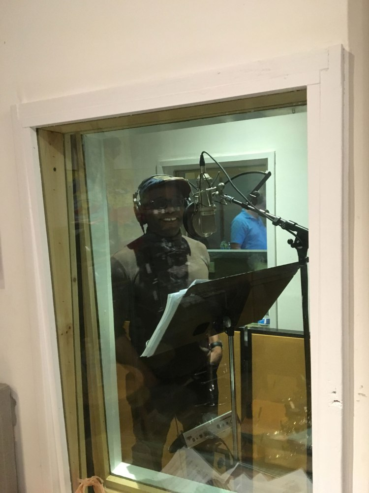 Tyehimba Jess in a sound booth in the recording studio