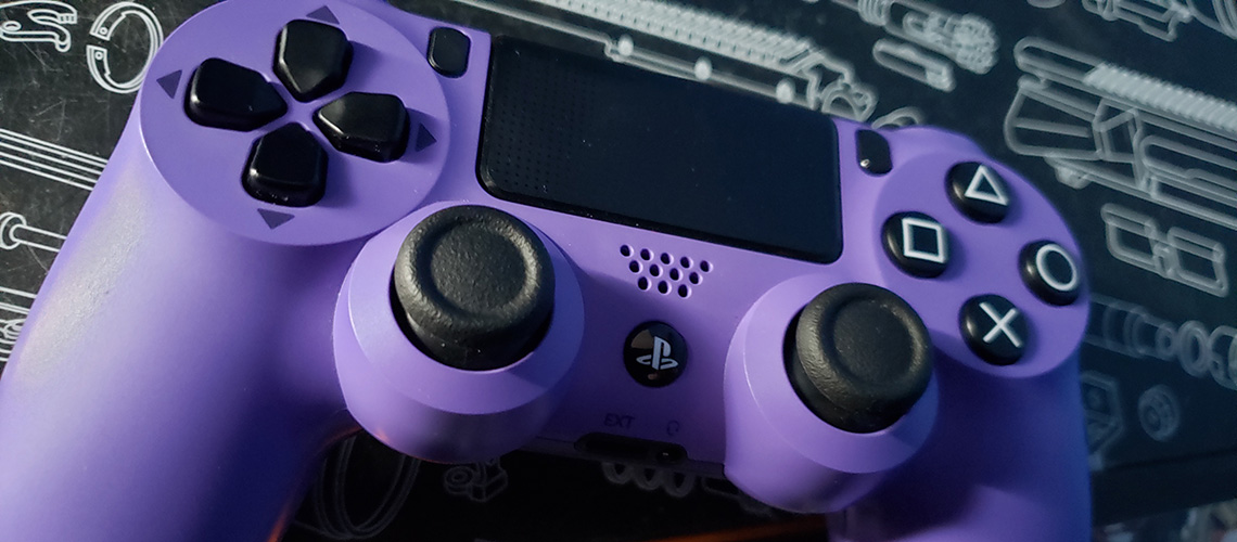 Purple PlayStation game controller