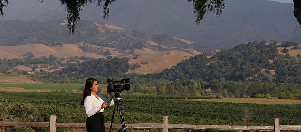 Fresno State alumna Gina Avalos sets up her shot for KSBY-TV.