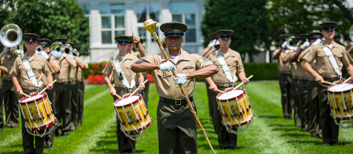 """Staff Sergeant Guy Barnes leads the """"The Commandant's Own"""" U.S. Marine Corps marching unit"""