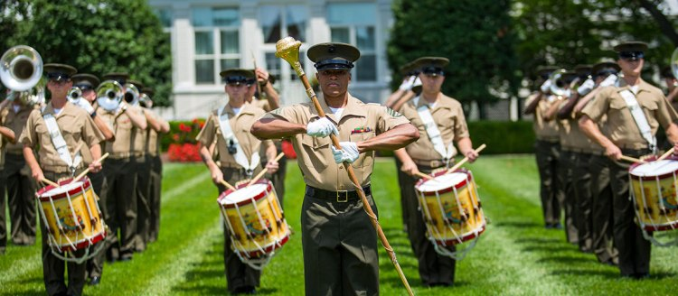 "Staff Sergeant Guy Barnes leads the ""The Commandant's Own"" U.S. Marine Corps marching unit"