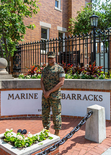 Staff Sergeant Guy Barnes in front of the Marine Barracks in Washington D.C.