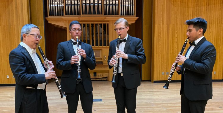 Dr. Miles Ishigaki (left) performs in the Fresno State Concert Hall.