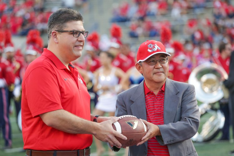 President I. Joseph Castro (left) and Dr. Miles Ishigaki at a Bulldog football game.