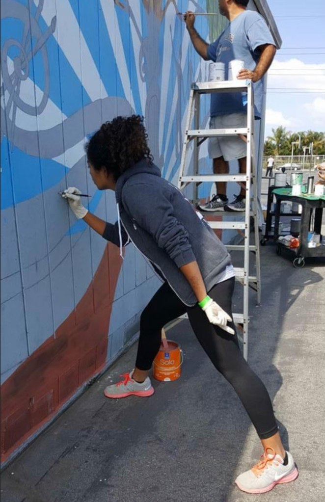 Kaelyn works on a mural in south-central Los Angeles.