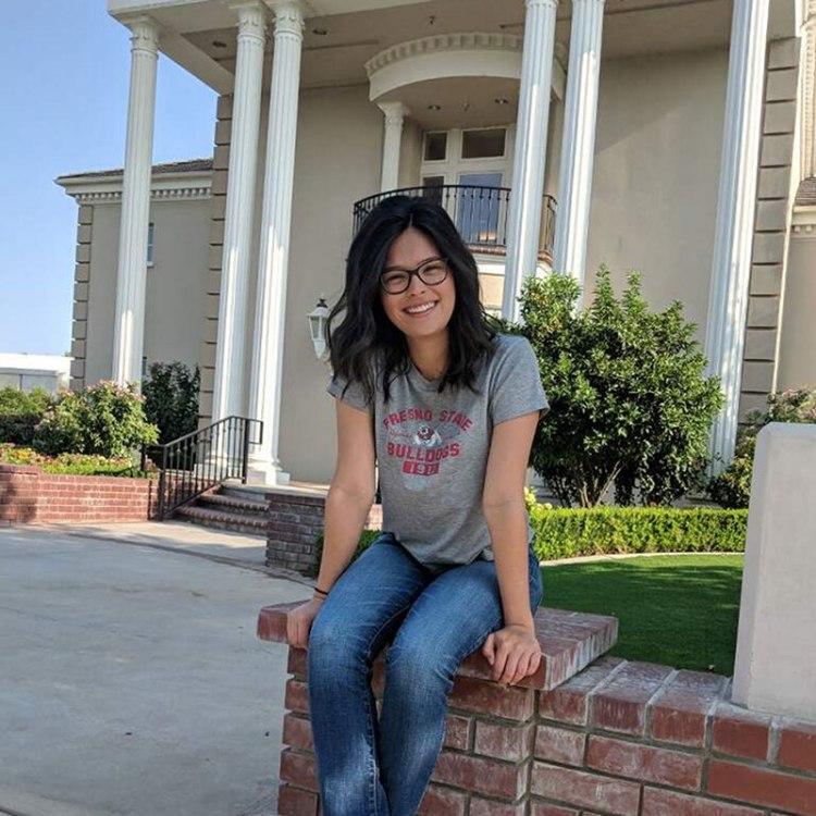 Victoria Cisneros in front of the Smittcamp Alumni House