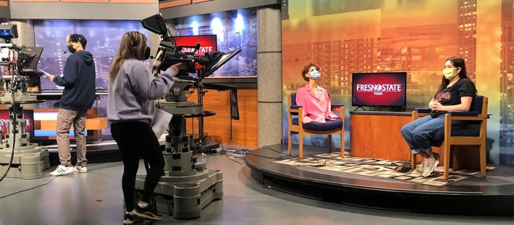 Fresno State Focus rehearses for upcoming newscast in the campus TV studio.