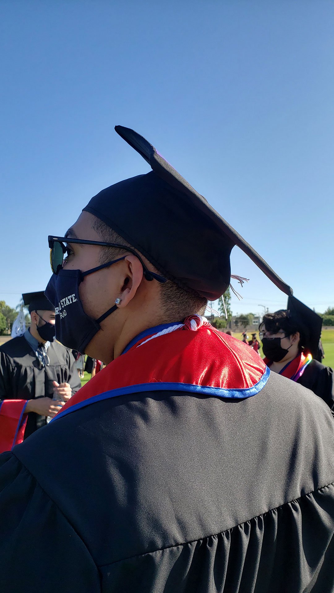 Student in mask and grad cap.