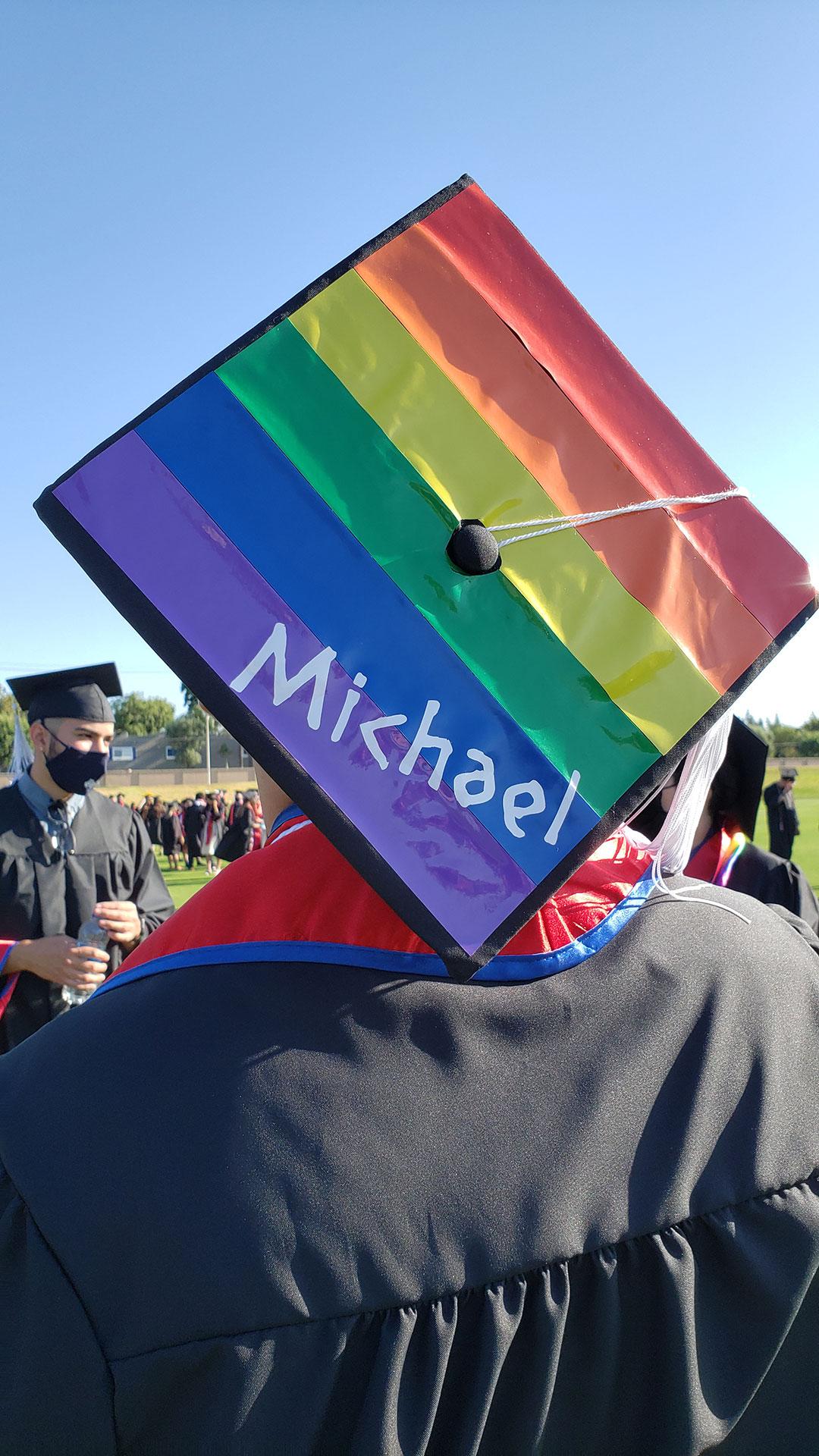 Michael's rainbow decorated grad cap.
