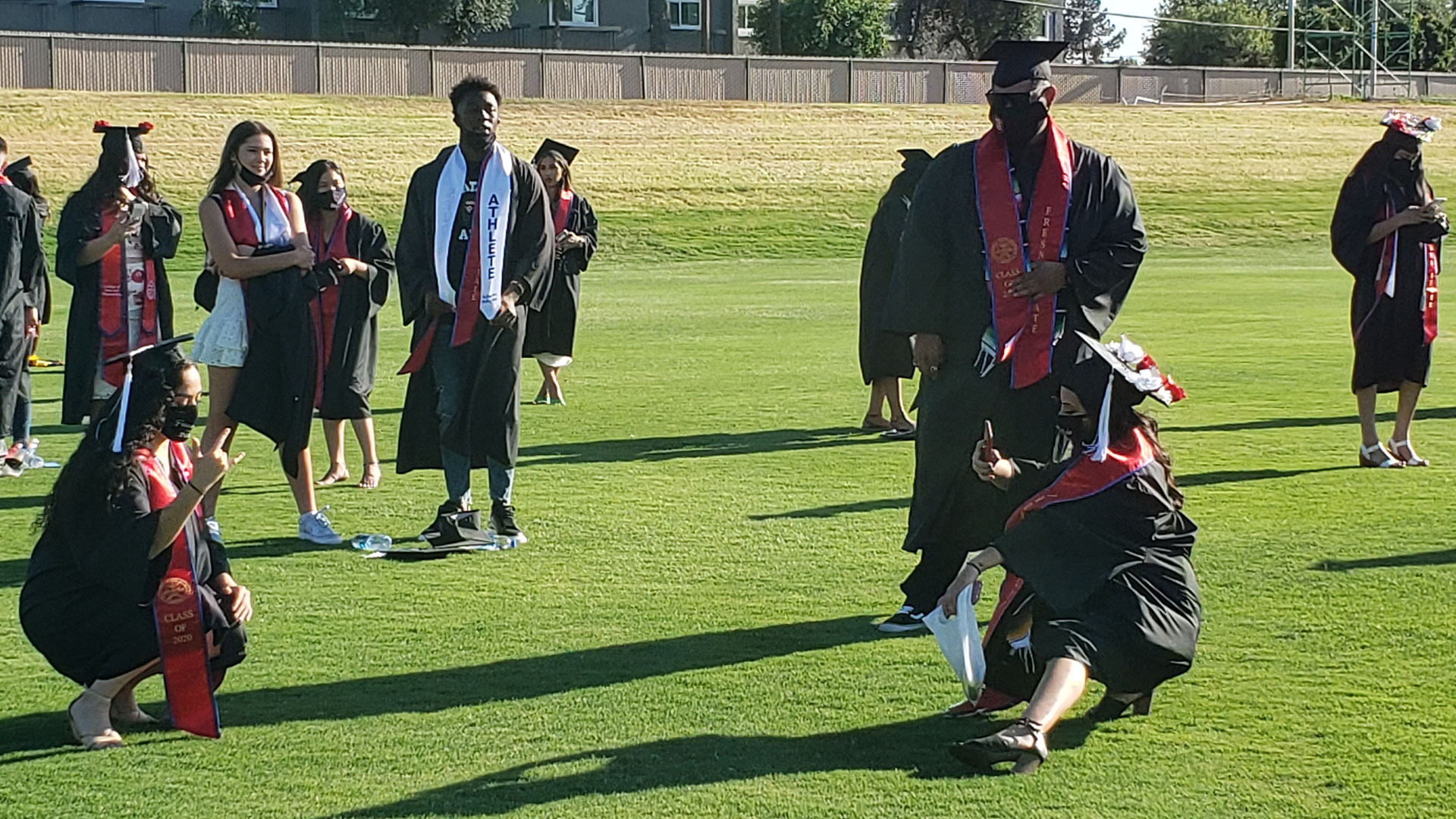 Grads pose for pictures ahead of the ceremony.