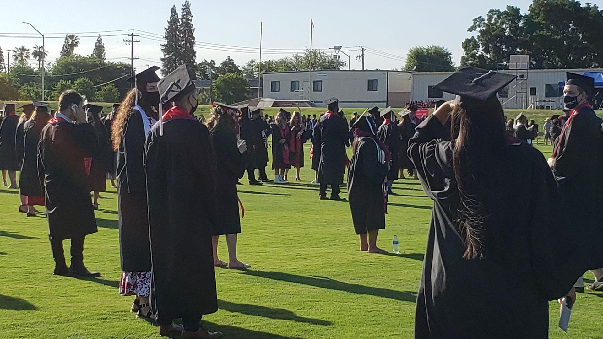 Grads prepare for the procession.