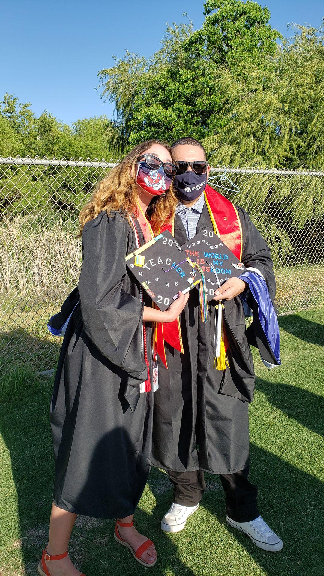 Grads show off their cap decorations.