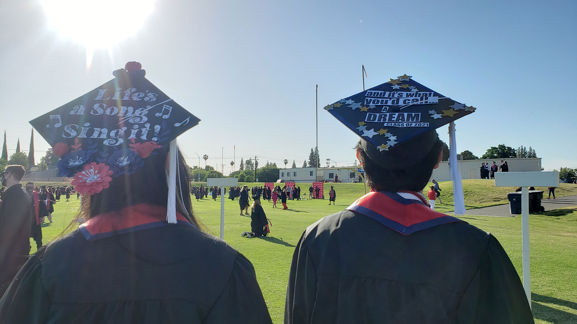 """Decorated grad caps, """"Life's a song, sing it!"""" """"and it's what you'd call a dream. Class of 2021."""""""