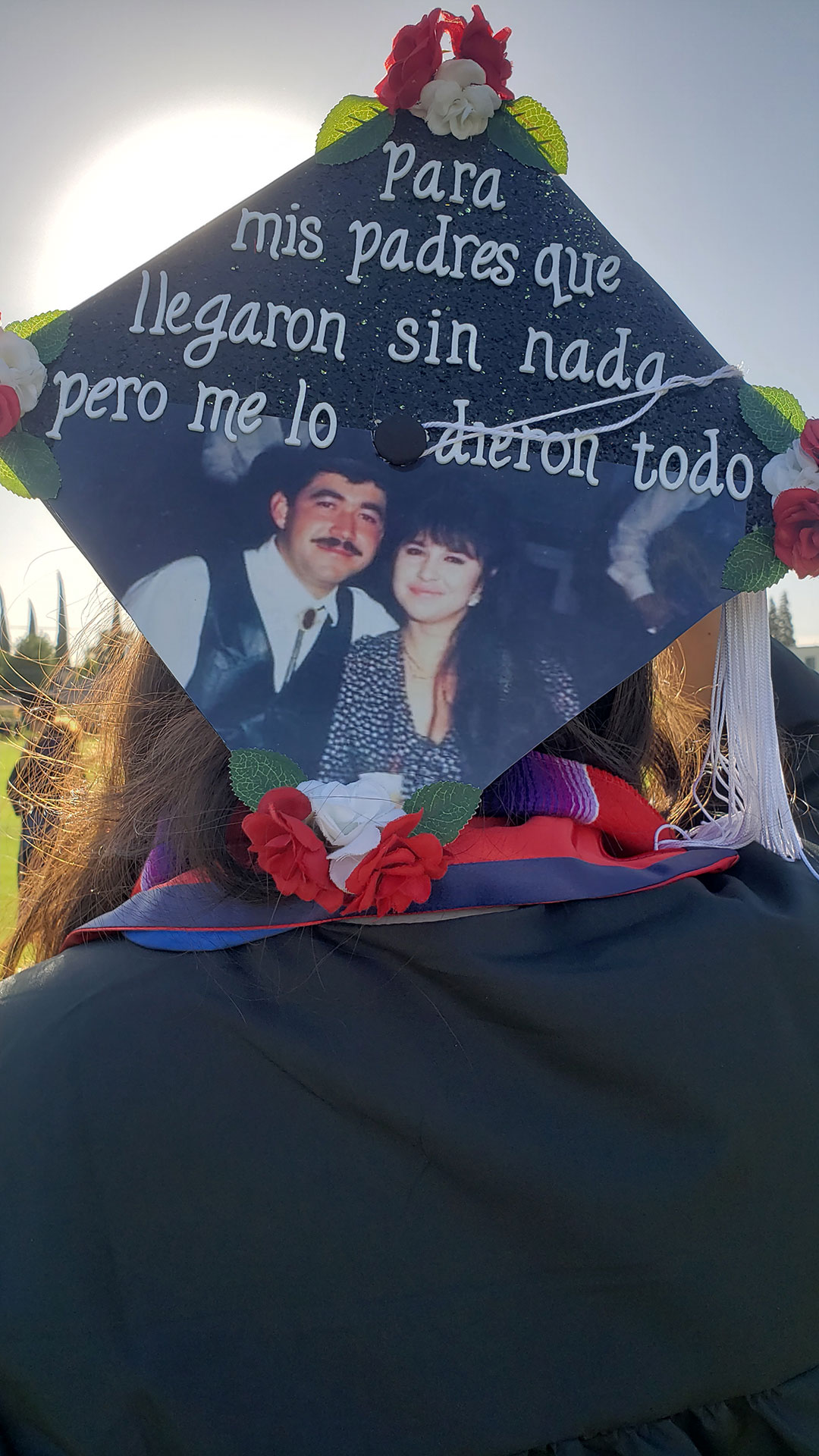 """Grad cap: """"For my parents who came with nothing but gave me everything."""""""