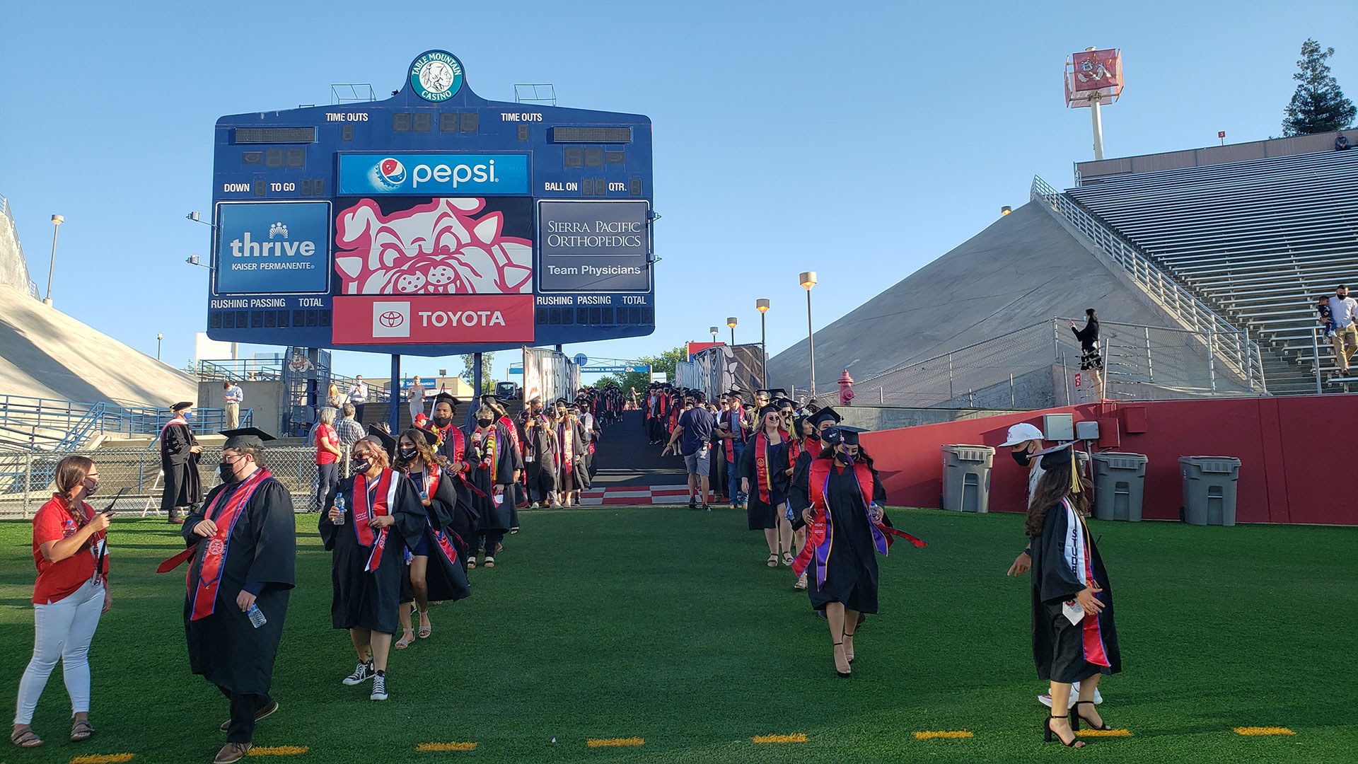 Students enter the stadium during the commencement ceremony.