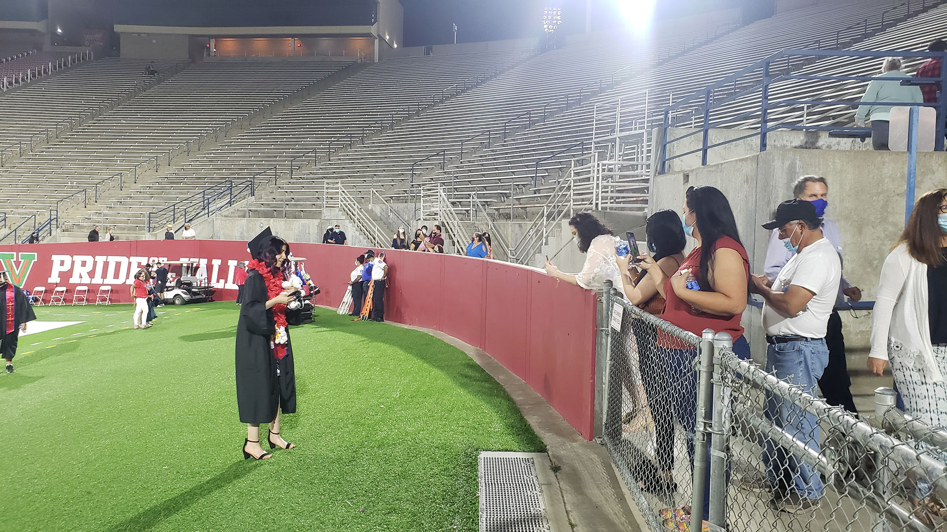 Student talks to her family after commencement.