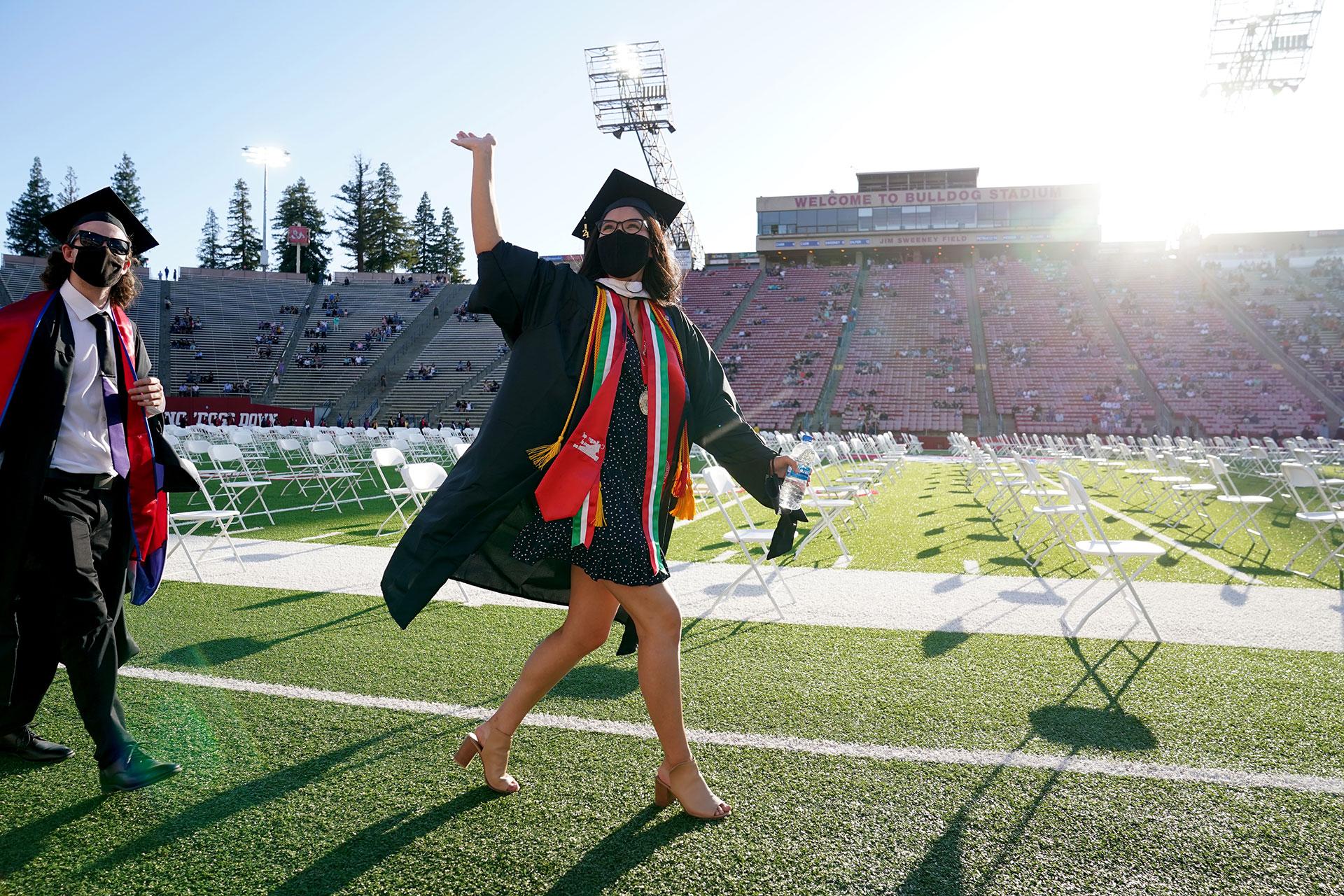 Grad walks into Bulldog Stadium. Photo by Cary Edmondson