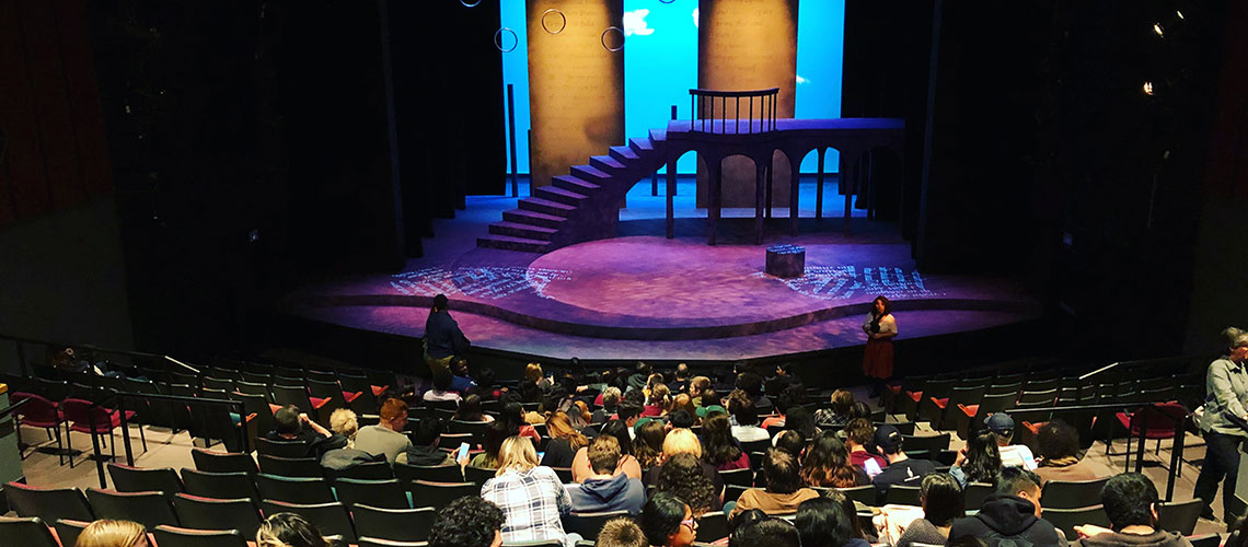 Photo from the back of the University Theatre overlooking the audience and looking onto the stage.
