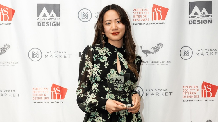 Alex Tsung holds her ANDYZ award at the Las Vegas Market ceremony.