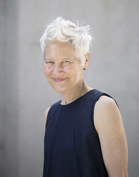 Photo of visual artist Ann Hamilton on a grey background.