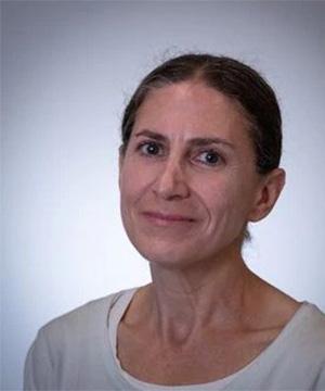 Headshot of Meredith Cohn in a white shirt